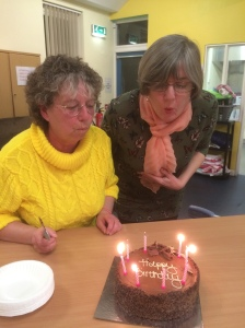 New and out-going Presidents Val Stevens and Liz Preston blow out the candles on our birthday cake
